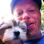 "Jesse Tyler Ferguson and his partner Justin Mikita with their Morkie ""Leaf."""
